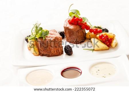 steak with fresh berries - stock photo