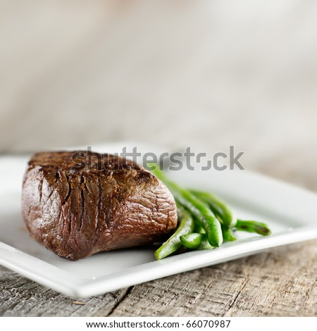 steak with green beans and copyspace - stock photo