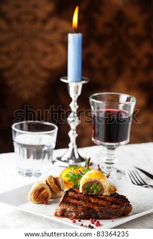 steak with grilled potato on a plate - stock photo