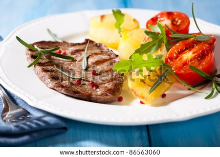 Steak with grilled vegetables and rosemary