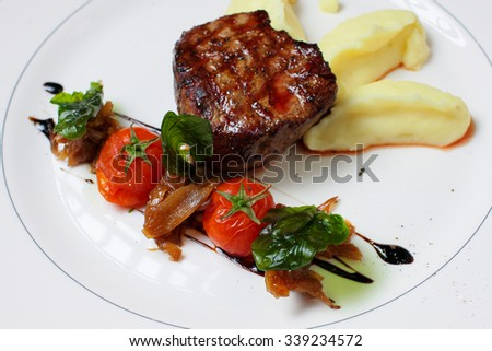 Steak with mashed and potatoes on a plate  - stock photo