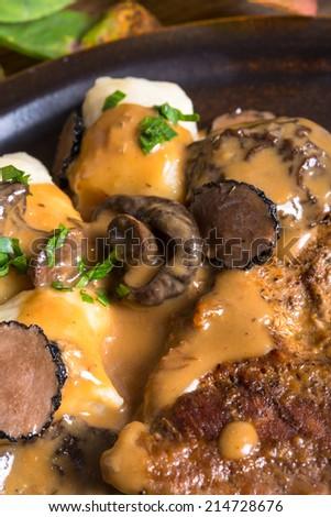 Steak with potato dumplings and forest mushroom sauce - stock photo