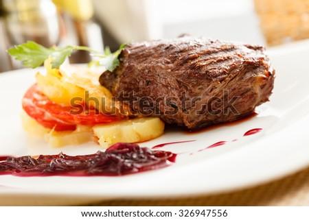 steak with potatoes - stock photo