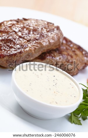 steak with sauce - stock photo