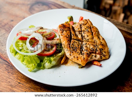 Steak with vegetable salad on a white plate. Restaurant - stock photo