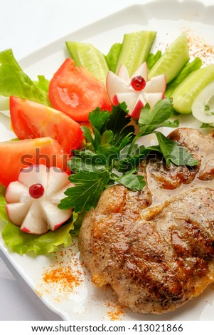 Steak with vegetables on a white background - stock photo