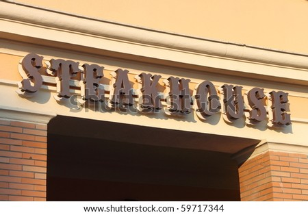 Steakhouse sign - stock photo