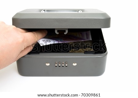 Stealing money from the cashbox. Isolated on white. - stock photo