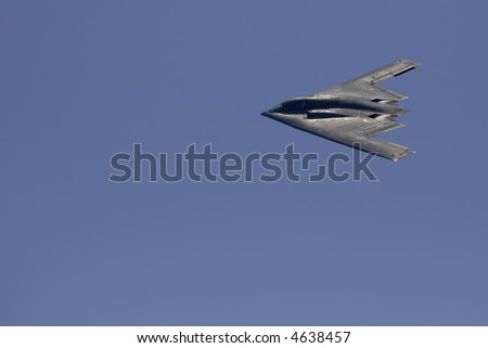 Stealth bomber with copyspace - stock photo