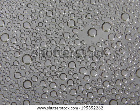 Steam condensed into water droplets on grey background