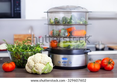 steam cooker with vegetables - stock photo