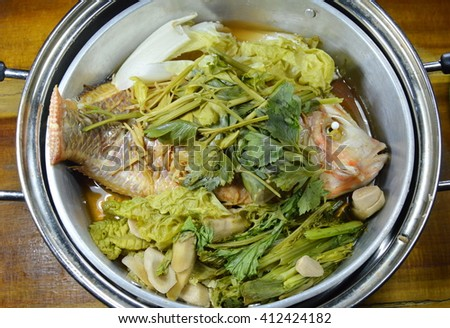 steam fish and vegetable in stainless steamer pot