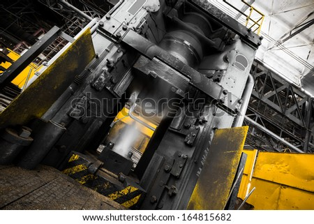 steam hammer before a usage in a forging workshop - stock photo