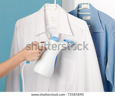 Steam iron to make housewife clothing works more easy - stock photo