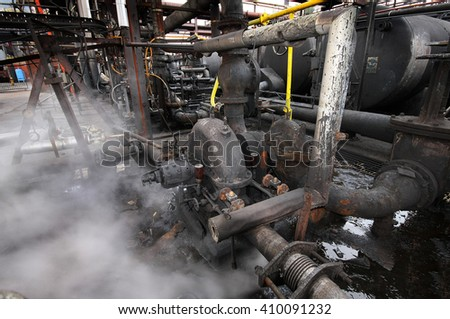 Steam leak from rotary pump unit on heavy industrial site.