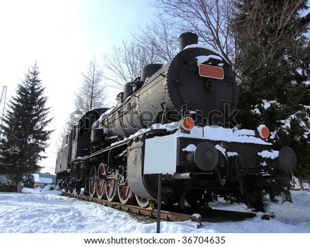 Steam locomotive in winter - stock photo
