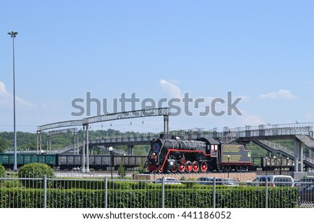 Steam locomotive - monument at the station square. Editorial image. Prokopyevsk, Kemerovo region, Russia. June 22, 2016. The monument - a steam locomotive placed on the forecourt.