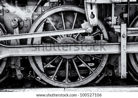 Steam locomotive wheels (black and white). - stock photo