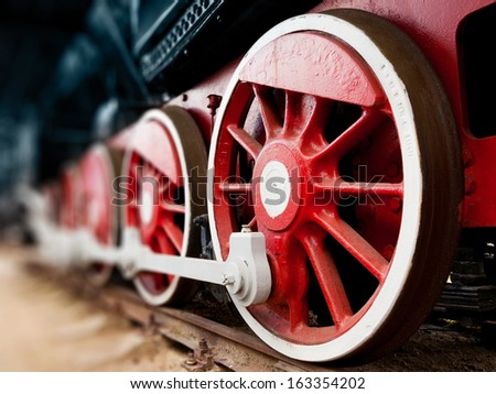 steam locomotive wheels close up - stock photo