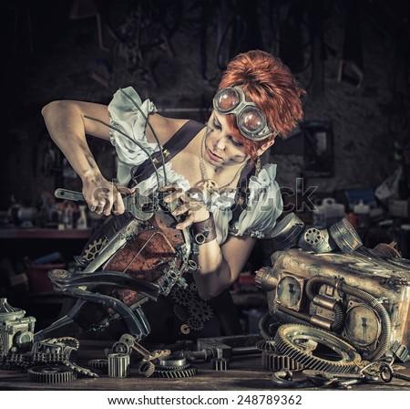 Steam-punk girl fixing her mechanical pet - stock photo