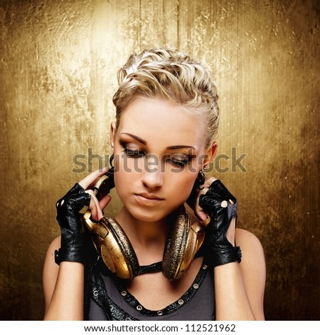 Steam punk girl with headphones - stock photo