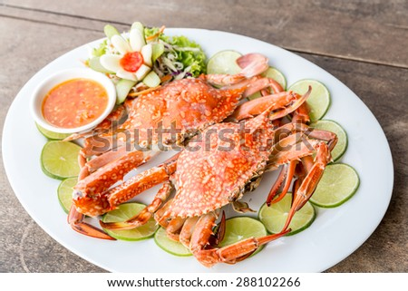 steam red crab with lemon lime and spicy seafood sauce - stock photo