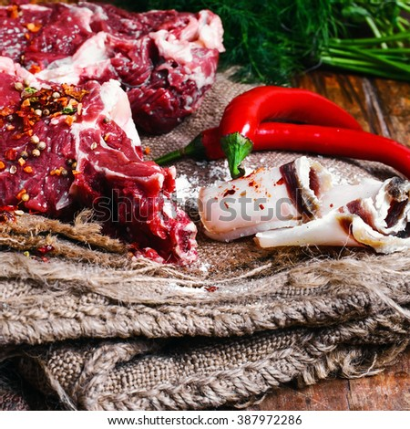 Steam the chopped pieces of beef with spices on burlap - stock photo