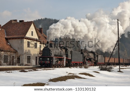 Steam train at a railway station - stock photo