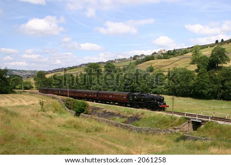Steam train in Bronte country, West Yorkshire - stock photo