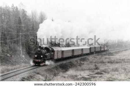 Steam train in full steam during Christmas with filters applied for a retro feeling. - stock photo