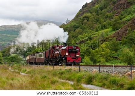 Steam train in Snowdonia, Wales - stock photo