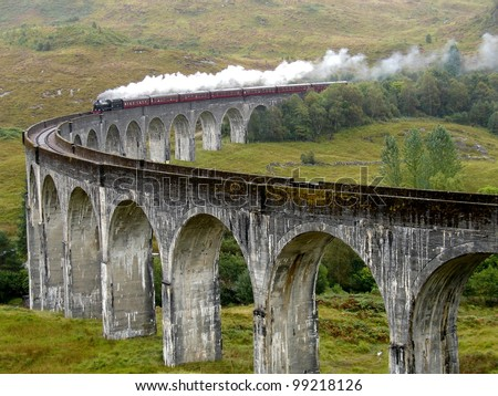 Steam train on Glenfinnan viaduct. Scotland. United Kingdom.  - stock photo