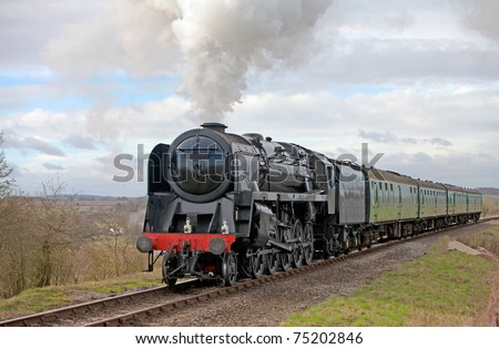 Steam train taking day trippers out for a nostalgic experience - Large steamer - stock photo