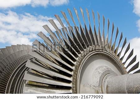 Steam turbine of nuclear power plant against a sky - stock photo
