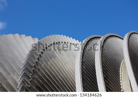 Steam turbine of nuclear power plant against sky - stock photo