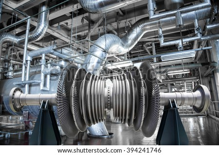 Steam turbine of power generator in an industrial thermal power plant - stock photo