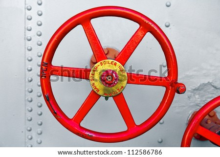 Steam valve from an old ship boiler.  Close up detail - stock photo