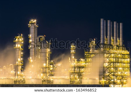 Steam vapor from the cooling fan in the chemical industry factory - stock photo