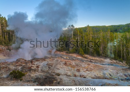 Steamboat Geyser, in Yellowstone National Park's Norris Geyser Basin - the world's tallest currently-active geyser. - stock photo