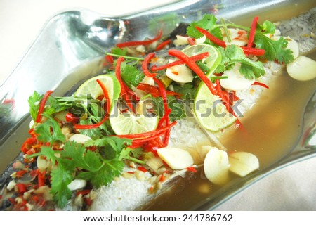 steamed bass with plum sauce - stock photo