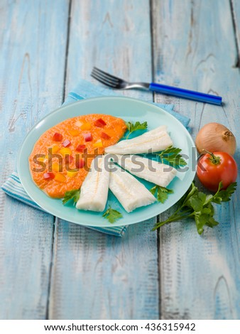 steamed cod with capsicum cream, selective focus  - stock photo