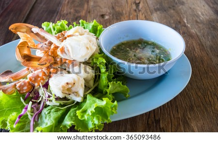 Steamed crab legs with spicy dip, seafood, thai style, Selective focus - stock photo