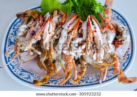 Steamed crabs on a dish are ready for eating. - stock photo