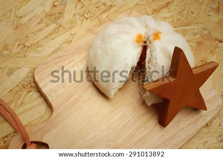 steamed dumpling - chinese bun on brown background.