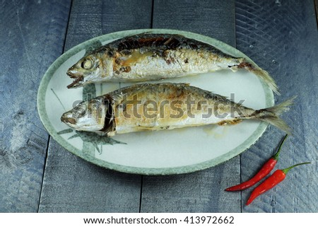 Steamed fish then fried