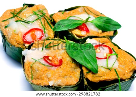 steamed fish with curry paste isolate on white background