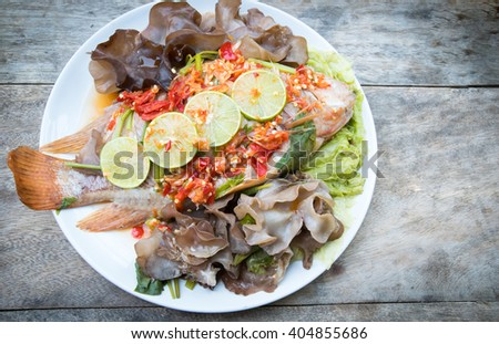 Steamed fish with spicy sauce, Thai food - stock photo