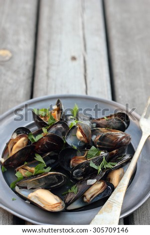 Steamed fresh mussels with wine and parsley.