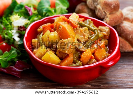 steamed mix of vegetables with meat and green beans - stock photo