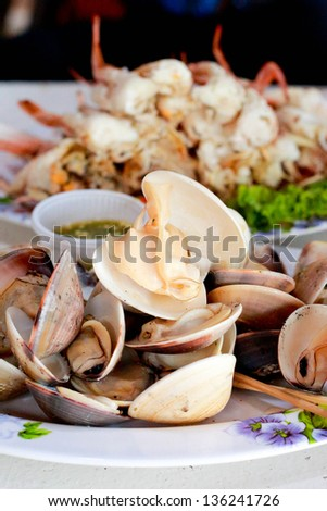 Steamed mussels with seafood sauce. - stock photo